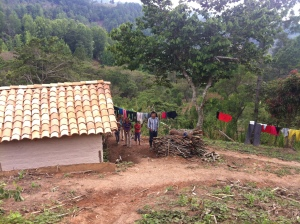 Reynaldo and some of his children in front of their house.