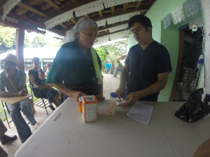 Elderly lady receiving her meds from doctor Jassyr