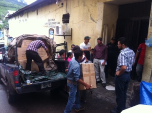Unloading the blankets and backpacks we brought for the inmates