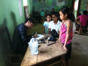 Dr. Almendarez writing a Receta (transcription)