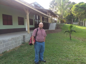 Allen Summy in front of School Building