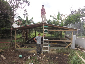 Enos and Fernando helping to build the chicken house