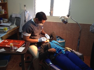 First Dental Brigade at the clinic with volunteer dentist from the area.